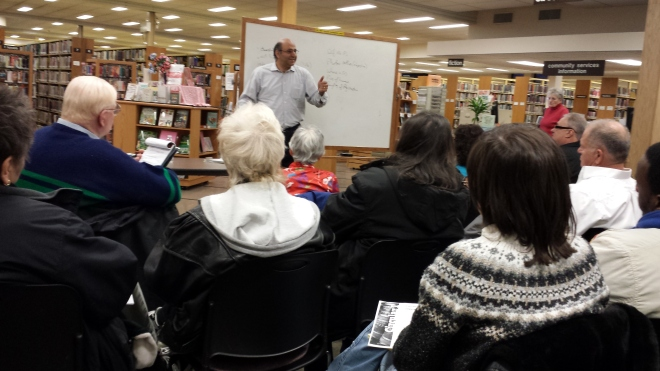 Attorney Omid Zareh discusses copyright basics at the East Meadow Public Library on Long Island.